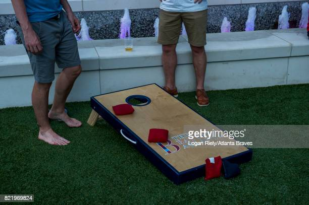 Fans playing Cornhole in an Plaza at There Battery during her game against the Philadelphia Phillies at SunTrust Park on June 8 2017 in Atlanta...