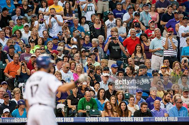 Fans point their cell phone cameras towards home plate as Todd Helton of the Colorado Rockies attempts to reach 2500 career hits in the second inning...