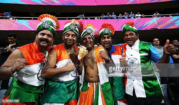 Fans pose ahead of the ICC World Twenty20 India 2016 SemiFinal match between West Indies and India at Wankhede Stadium on March 31 2016 in Mumbai...