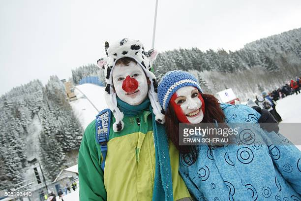 Fans pose ahead of the Ski Flying World Championships at Kulm Bad Mitterndorf Austria on January 16 2016 / AFP / APA / ERWIN SCHERIAU / Austria OUT