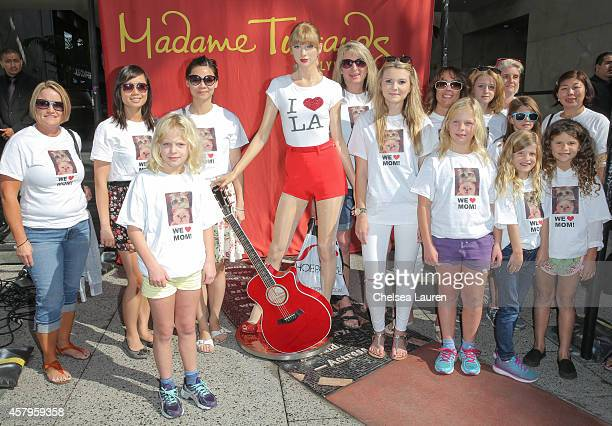 Fans pose as Madame Tussauds Hollywood Unveils Never Before Seen Taylor Swift Figure in celebration of the Grammy Award winner's new album '1989' at...