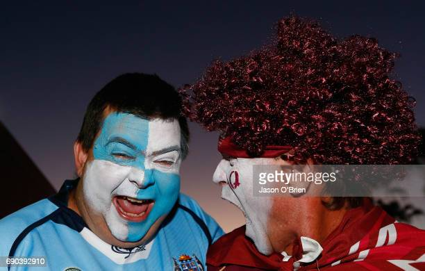 Fans pose for a photo during game one of the State Of Origin series between the Queensland Maroons and the New South Wales Blues at Suncorp Stadium...