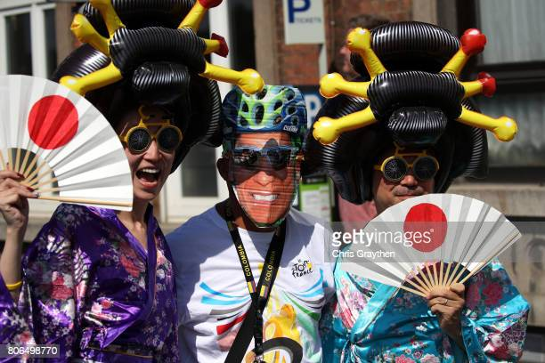 Fans pose for a photo during stage three of the 2017 Le Tour de France a 2125km stage from Verviers to Longwy on July 3 2017 in Verviers France