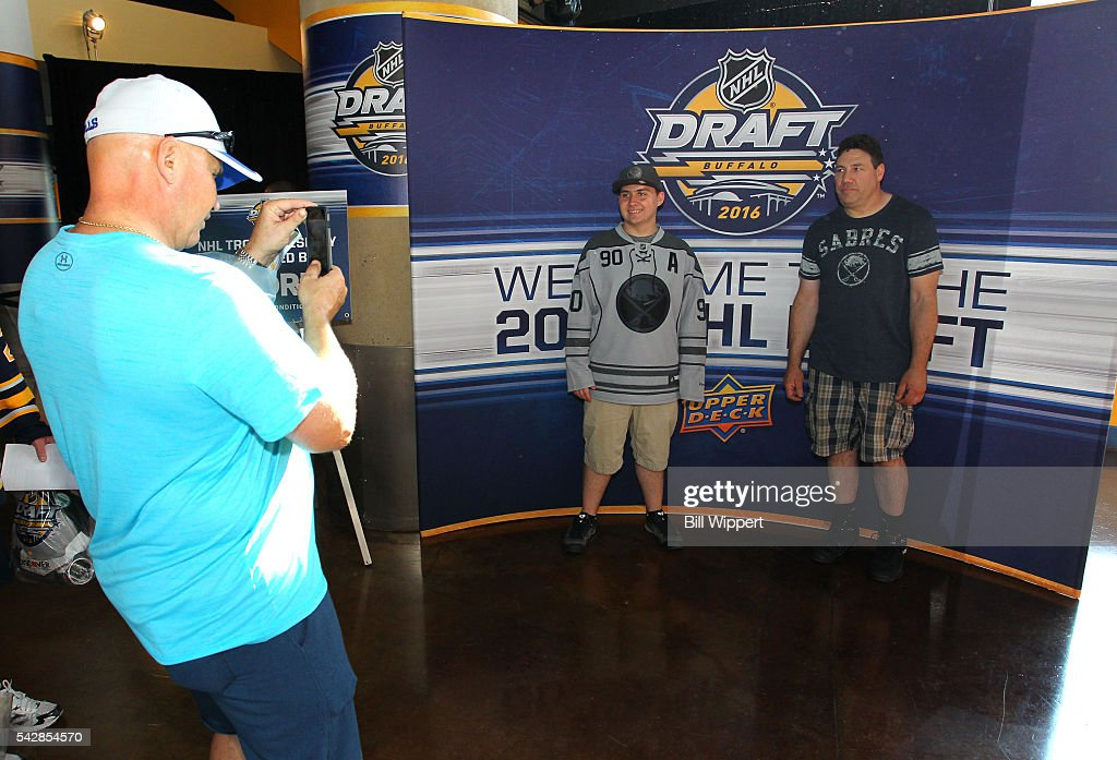 Fans pose for a photo in a booth prior to round one of the 2016 NHL Draft at First Niagara Center on June 24, 2016 in Buffalo, New York.