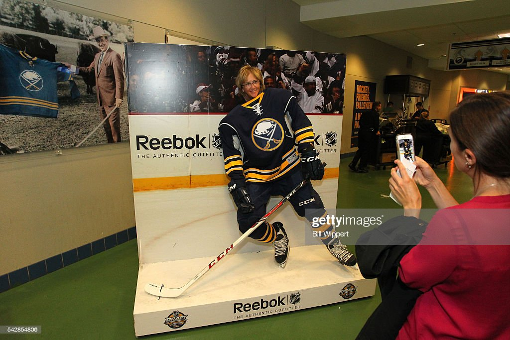 Fans pose for a photo in a Reebok booth prior to round one of the 2016 NHL Draft at First Niagara Center on June 24, 2016 in Buffalo, New York.
