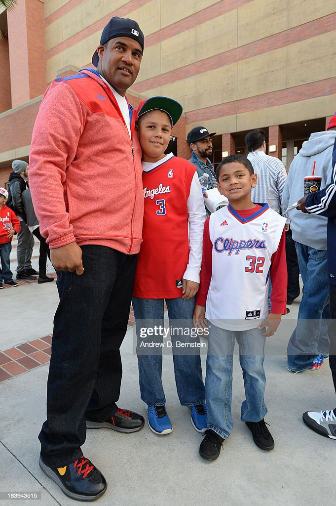 Fans pose for a photo outside Galen Center before a Los Angeles Clippers open scrimmage on October 9, 2013 in Los Angeles, California.