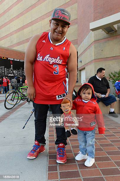 Fans pose for a photo outside Galen Center before a Los Angeles Clippers open scrimmage on October 9 2013 in Los Angeles California NOTE TO USER User...