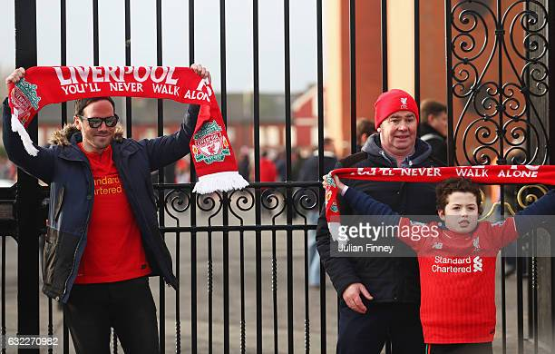 Fans pose for a photo outside the stadium prior to the Premier League match between Liverpool and Swansea City at Anfield on January 21 2017 in...