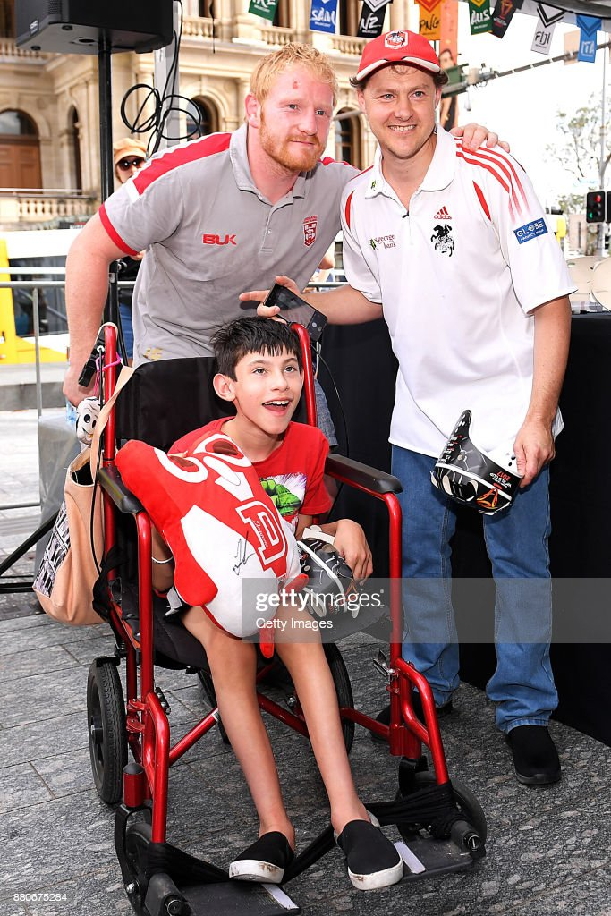 Fans pose for a photo with James Graham of England during an Australia Kangaroos and England Signing Session at Reddacliff Place on November 28, 2017 in Brisbane, Australia.