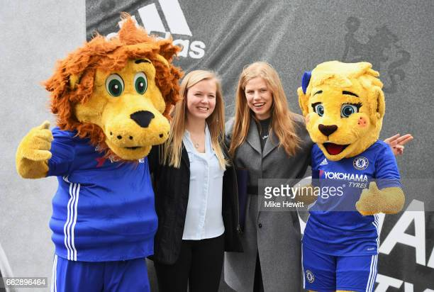 Fans pose for a photograph with the two Chelsea mascots prior to the Premier League match between Chelsea and Crystal Palace at Stamford Bridge on...