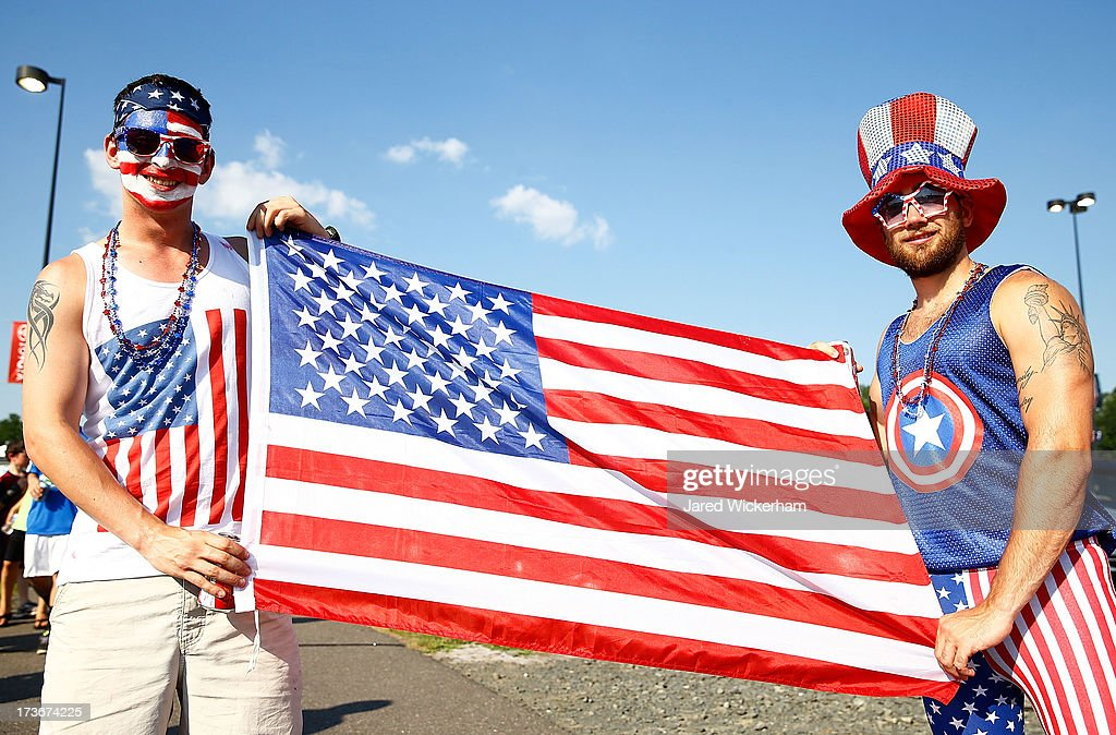 USA fans pose for a portrait outside of the stadium with the American flag prior to the USA vs Costa Rica CONCACAF Gold Cup match at Rentschler Field on July 16, 2013 in East Hartford, Connecticut.