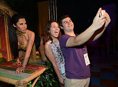 Fans pose for photos with Madame Tussauds first Nicki Minaj wax figure In Las Vegas on August 4 2015 in Las Vegas Nevada