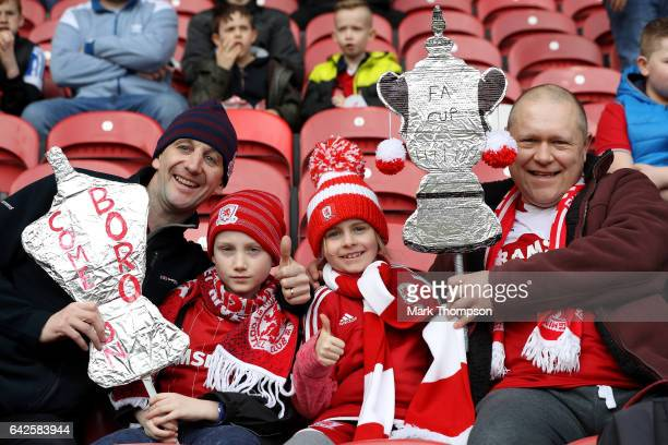 Fans pose fora photograph with their home made FA Cup trophy prior to The Emirates FA Cup Fifth Round match between Middlesbrough and Oxford United...