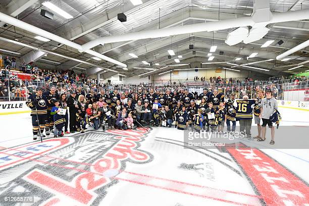Fans pose on the ice with there team signed Buffalo Sabres Kraft Hockeyville jerseys after the NHL preseason game at Lakeview Arena on October 4 2016...