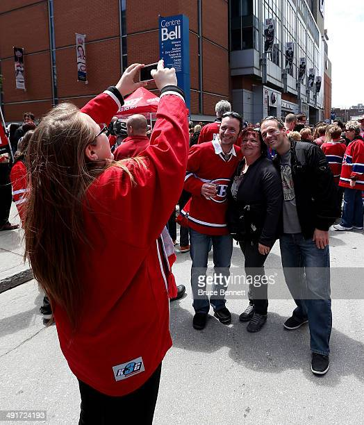 Fans pose outside before Game One of the Eastern Conference Finals of the 2014 NHL Stanley Cup Playoffs between the New York Rangers and the Montreal...