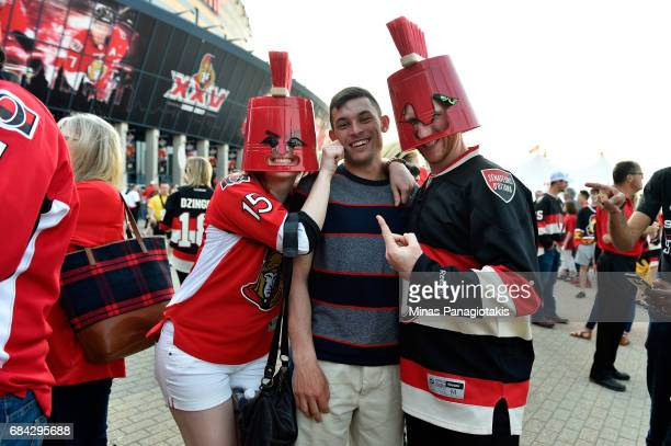 Fans pose outside the arena prior Game Three of the Eastern Conference Final between the Pittsburgh Penguins and the Ottawa Senators during the 2017...
