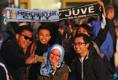 Fans pose outside the ground prior to the UEFA Champions League Group D match between Manchester City FC and Juventus at the Etihad Stadium on...