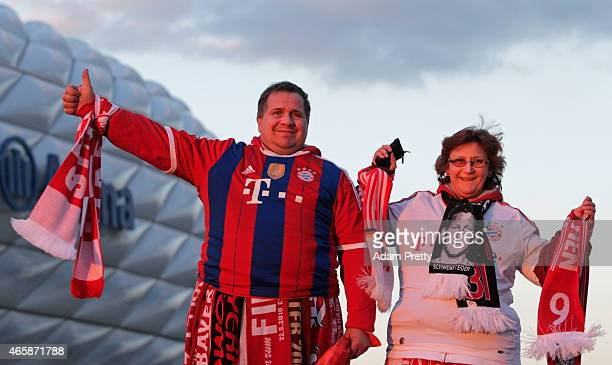 Fans pose outside the stadium prior to the UEFA Champions League Round of 16 second leg match between FC Bayern Muenchen and FC Shakhtar Donetsk at...