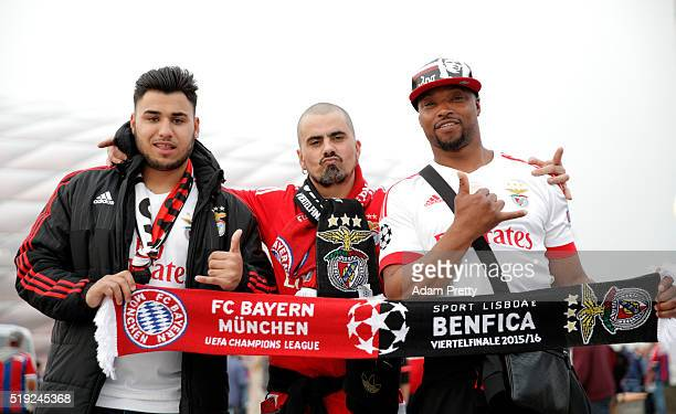 Fans pose outside the stadium prior to the UEFA Champions League quarter final first leg match between FC Bayern Muenchen and SL Benfica at Allianz...