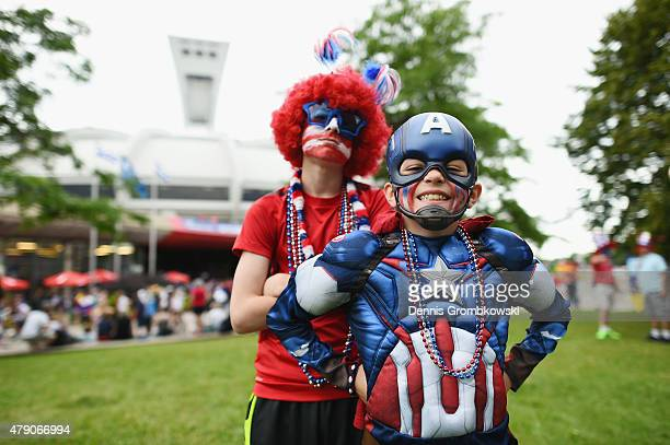 USA fans pose prior to kickoff for the FIFA Women's World Cup 2015 SemiFinal Match at Olympic Stadium on June 30 2015 in Montreal Canada