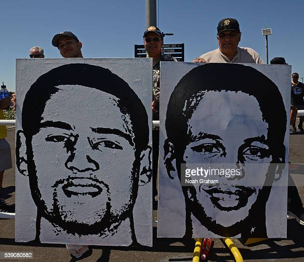 Fans pose with Klay Thompson and Stephen Curry of the Golden State Warriors posters before Game Two of the 2016 NBA Finals against the Cleveland...