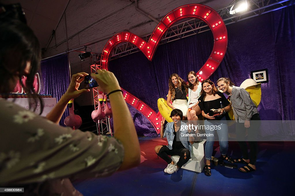 Fans pose with props from Katy Perry's live show at Katy Perry's PopUp shop on November 12 2014 in Melbourne Australia