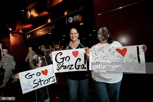 Fans pose with signs prior to Game Two of the WNBA Finals between the Detroit Shock and San Antonio Silver Stars on October 3 2008 at ATT Center in...