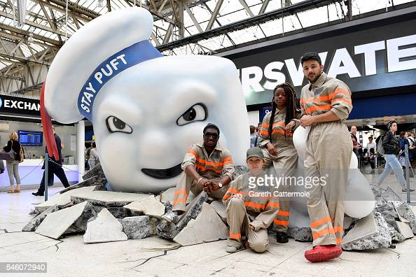 Fans pose with Stay Puft Marshmallow Man on the concourse at Waterloo Station on July 11 2016 in London England Ghostbusters take over Waterloo...