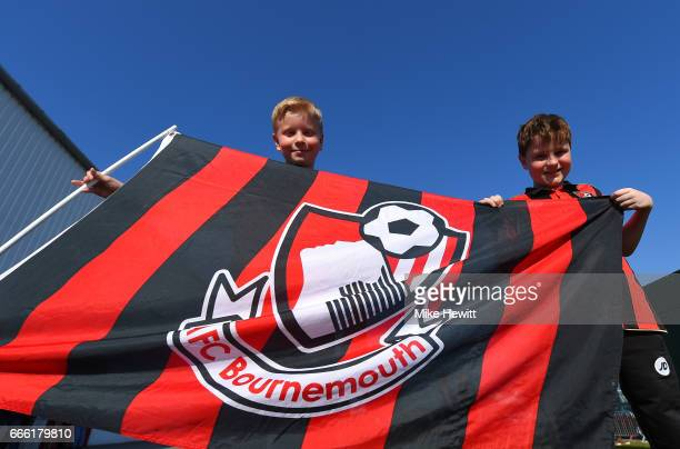 Fans pose with their flag outisde the stadium prior to the Premier League match between AFC Bournemouth and Chelsea at Vitality Stadium on April 8...