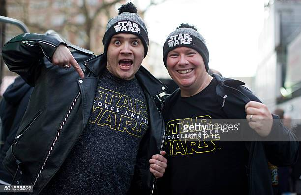 Fans poses with their film sweatshirts as they queue ahead of the European Premiere of 'Star Wars The Force Awakens' in central London on December 16...
