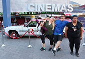 Fans posing in front of the 'Ghostbusters' Cadillac Fleetwood Station Wagon at AMC Universal City Walk on July 14 2016 in Universal City California