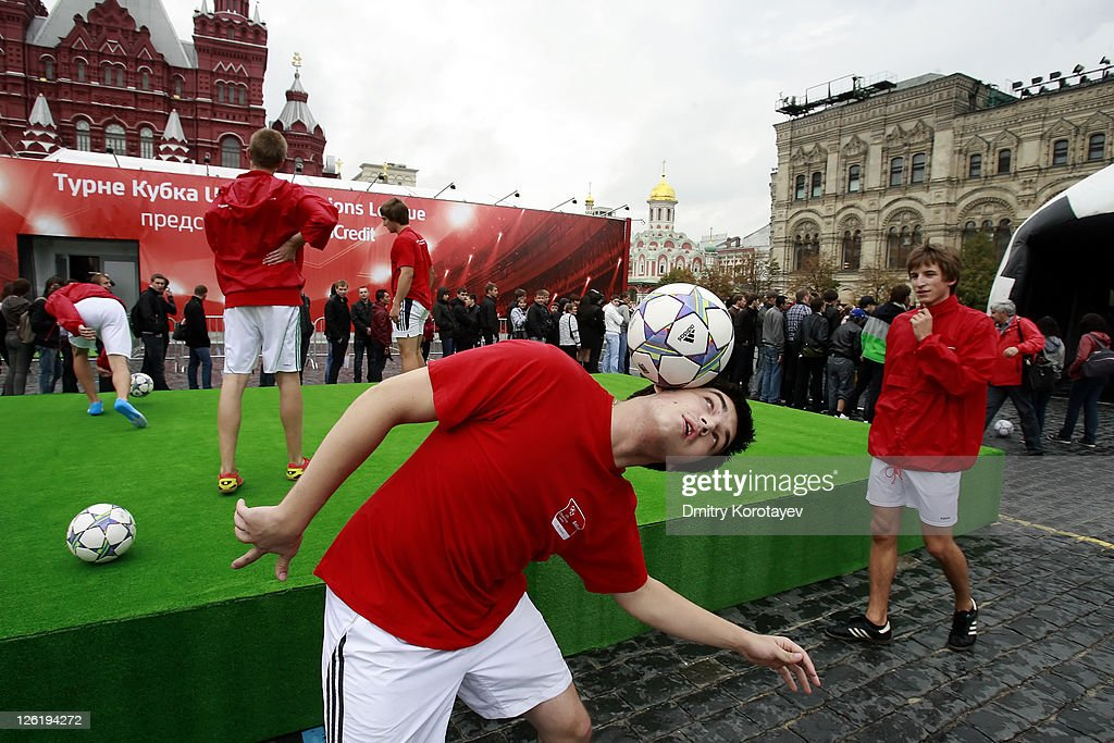 Fans practice their football skills as they attend the UEFA Champions League Trophy Tour 2011 on September 23, 2011 in Moscow, Russia.
