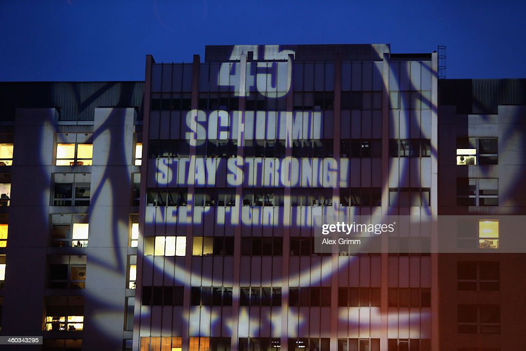Fans project a message reading '45 - Schumi Stay strong! Keep fighting!' on a wall of the Grenoble University Hospital Centre where former German Formula One driver Michael Schumacher is being treated for a severe head injury following a skiing accident on Sunday in Meribel on January 3, 2014 in Grenoble, France.
