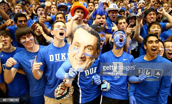 Fans pull for head coach Mike Krzyzewski of the Duke Blue Devils prior to their game against the Pittsburgh Panthers at Cameron Indoor Stadium on...