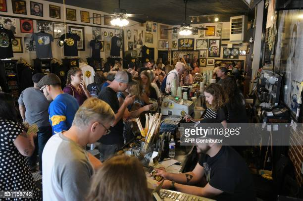 Fans purchase tour tickets and souvenirs inside the cafe at Sun Studio where Elvis Presley made his first recordings on August 13 2017 in Memphis...