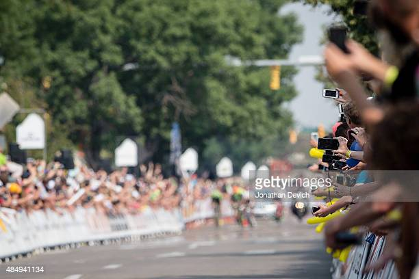 Fans push cell phones out to capture the finish of stage 6 of the USA Pro Challenge on August 22 2015 in Fort Collins Colorado