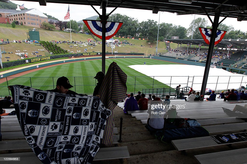 Fans put out a blanket in the stands during a rain delay before the start of the Little League World Series championship game between the Japan team from Hamamatsu City, Japan and the West team from Huntington Beach, California on August 28, 2011 in South Williamsport, Pennsylvania.
