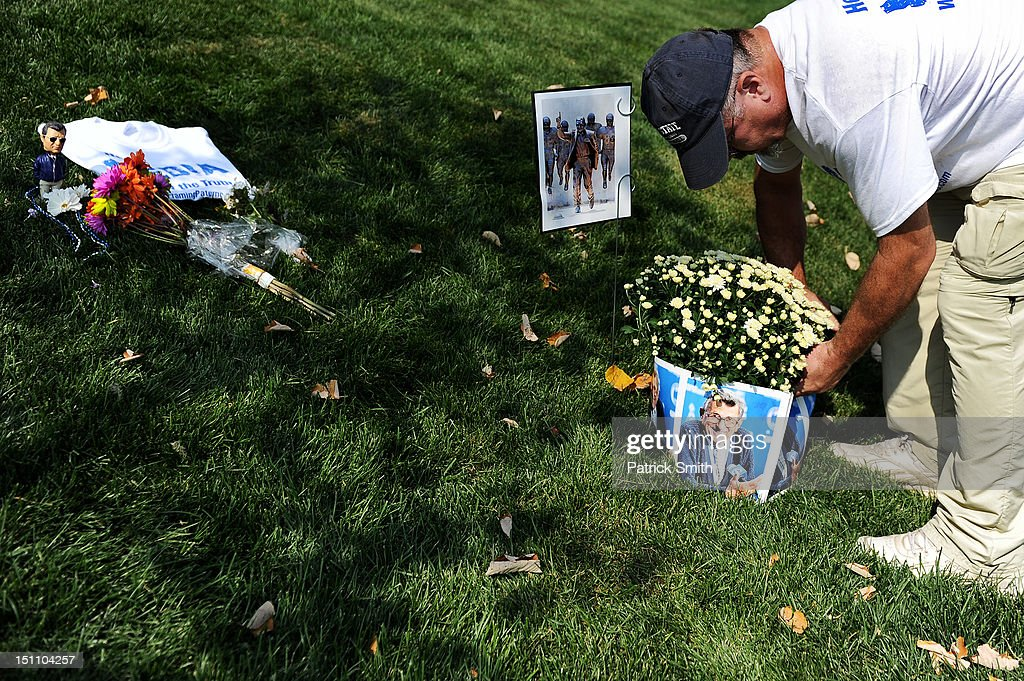 A fans puts plants down at the former site of the Joe Paterno statue prior to the Penn State playing the Ohio Bobcats at Beaver Stadium on September 1, 2012 in State College, Pennsylvania.