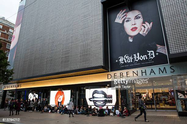 Fans queue outside Debenhams Oxford Street to meet tattoo artist and television personality Kat Von D at the Kat Von D Beauty UK launch on October 8...