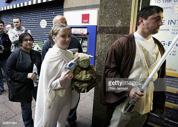 Fans queue outside the Empire cinema for the first ever screening of the entire sixfilm Star Wars saga in Leicester Square on May 16 2005 in London...