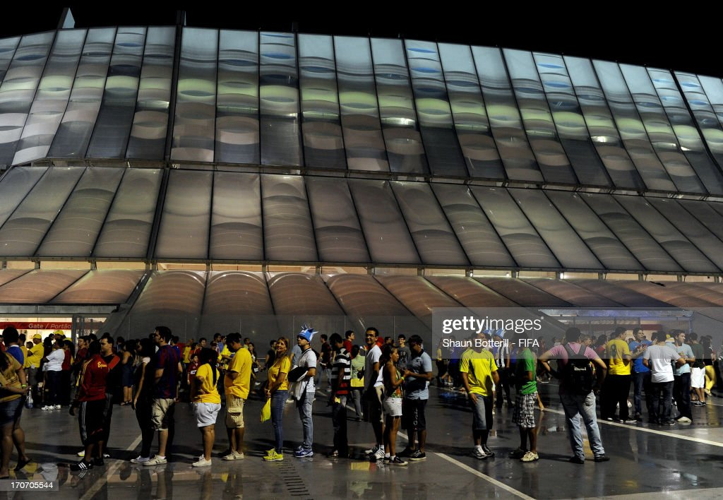 Fans queue outside the stadium prior to the FIFA Confederations Cup Brazil 2013 Group B match between Spain and Uruguay at the Arena Pernambuco on June 16, 2013 in Recife, Brazil.