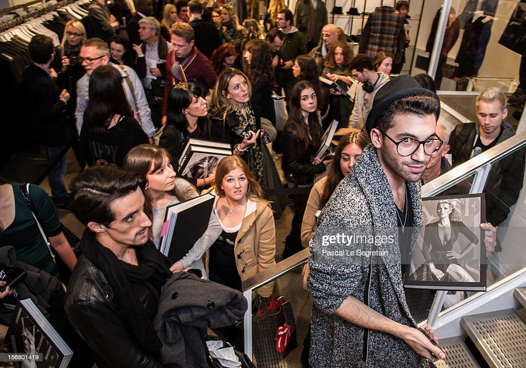 Fans queue to attend the Kate Moss signing session for the book 'Kate: The Kate Moss Book' at Colette on November 21, 2012 in Paris, France.