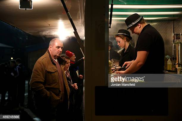 Fans queue up to buy snacks ahead of the FA Cup First Round Replay match between Aldershot Town and Portsmouth at The Electrical Services Stadium on...