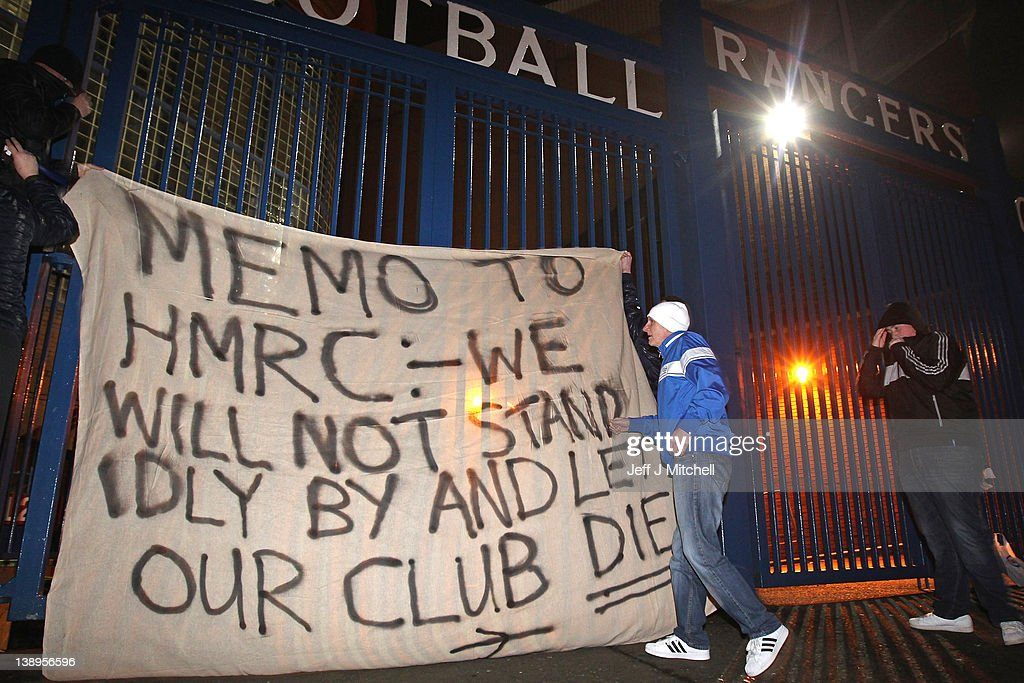 Fans raise a banner on the gates of Ibrox Stadium on February 14, 2012 in Glasgow, Scotland. HM Revenue and Customs lodged a petition at the Court of Session to put Glasgow Rangers Football Club into administration. This counteracts moves by owner Craig Whyte, who yesterday gave notice of the clubs intent to go into administration. HMRC is in dispute with the Scottish Premier League Champions over a £49million pound tax bill.