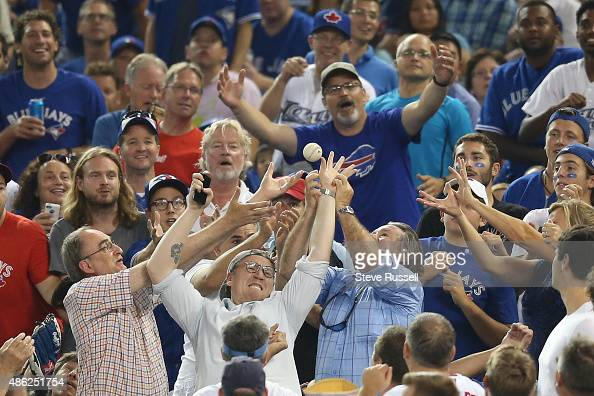 TORONTO ON SEPTEMBER 2 Fans reach for a foul ball as the Toronto Blue Jays beat the Cleveland Indians 51 at the Rogers Centre in Toronto September 2...