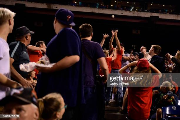 Fans reach for a foul ball between the Philadelphia Phillies and the Oakland Athletics during the fourth inning at Citizens Bank Park on September 16...