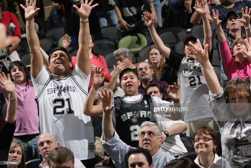 Fans reach for tee-shirts, tossed by cheerleaders, during the NBA game between the San Antonio Spurs and the Denver Nuggets on February 20, 2007 at AT&T Center in San Antonio, Texas. The Spurs won 95-80.