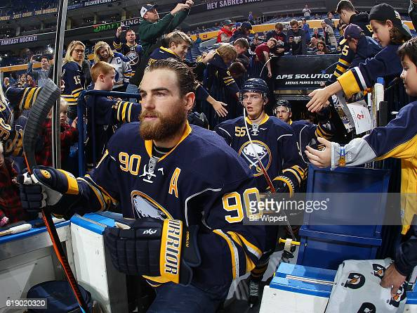 Fans reach out as Ryan O'Reilly of the Buffalo Sabres takes to the ice for warms up before an NHL game against the Florida Panthers at the KeyBank...
