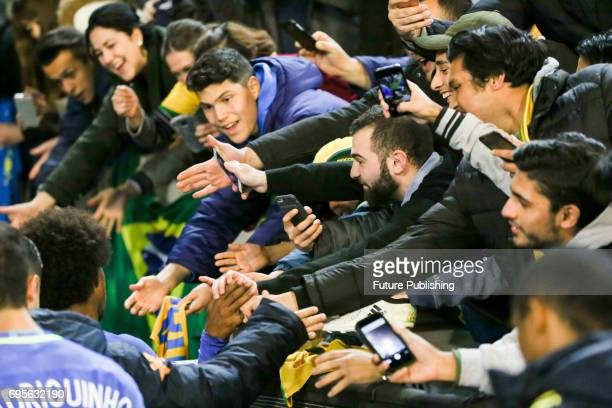Fans reach out for Brazilian players after Brazil beat Australia in the Chevrolet Brasil Global Tour 2017 on June 13 2017 in Melbourne Australia...