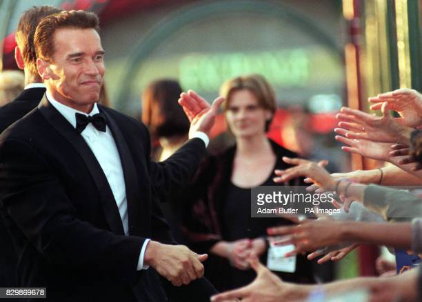 Fans reach out to shake hands with American actor Arnold Schwarzenegger in London for the UK premiere of his latest film 'Eraser' at the Warner Bros...